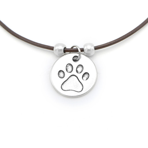 LILO Collections Paw Print Disc Skinny leather necklace, pictured on brown cord