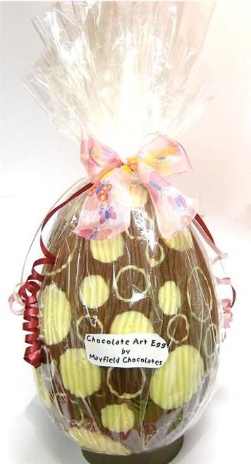 Hollow milk chocolate art egg 215mm high $35.00