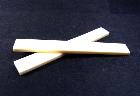 Large bone saddle blanks for acoustic guitars.  Set of 2.