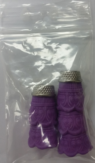 """These silicon thimbles help protect your fingers whilst sewing. They have steel tops with 1 thimble per blister pack. They are a purple colour and size M""""."""