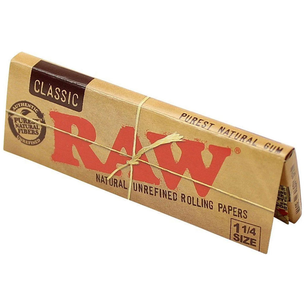 A single pack of Raw Classic 1 1/4 Rolling Papers standing upright.