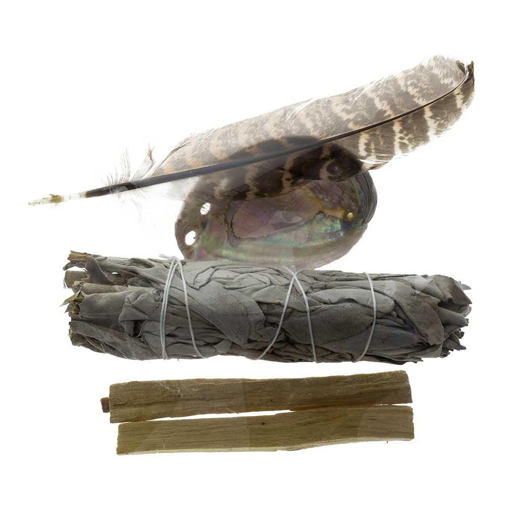 Sage Smudge Kit comes complete with one feather, one smudging shell, one bundle of white sage, and two pieces of Palo Santo wood.