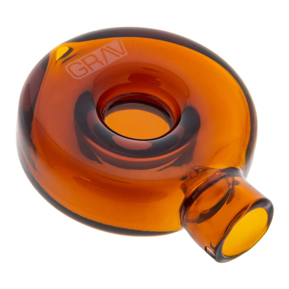 Profile view of Grav's Donut Chillum. This unique piece is disk-shaped, with a ringed chamber for smoke.