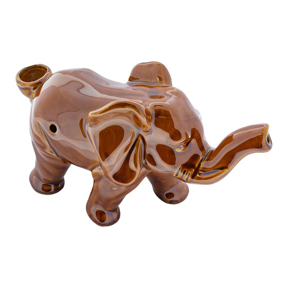 The Lucky Elephant pipe as seen from a high profile view. The trunk is raised, which is a sign of showering wealth. The carb is located on the right side of its body, the bowl in the back by the tail, and the mouth of the pipe is at the tip of the trunk.