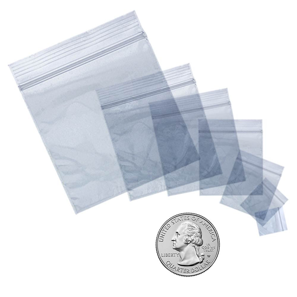 """Check out all the sizes of Apple Brand Bags here, pictured relative to a quarter for size reference. A quarter is just under 1"""" wide, and all the bags pictured here are from largest to smallest, left to right: 2020, 1515, 125125, 1010, 1212, 3434, and 3838."""