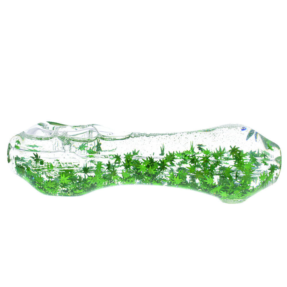A glycerin freezable liquid filled hand pipe with green leaf confetti glitter  that is also UV reactive.
