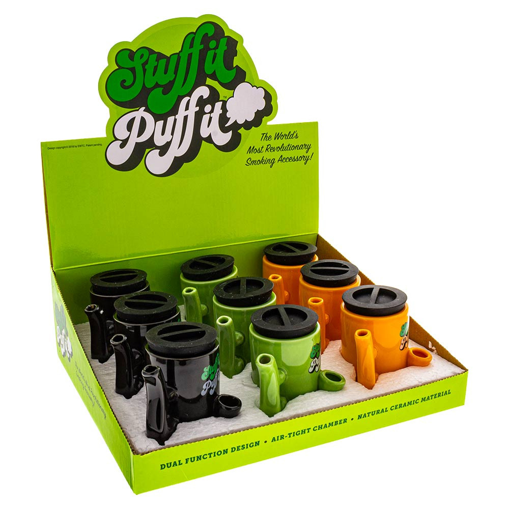 Stuff It Puff It Display Box opened and containing 3 mugs of each of the 3 colors for a total of 9 stash pipes.