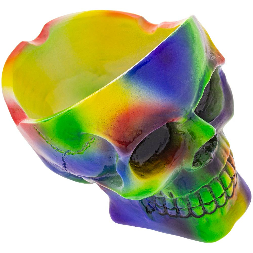 Profile view of this rainbow skull ashtray from above, showing both the face and ash tray.