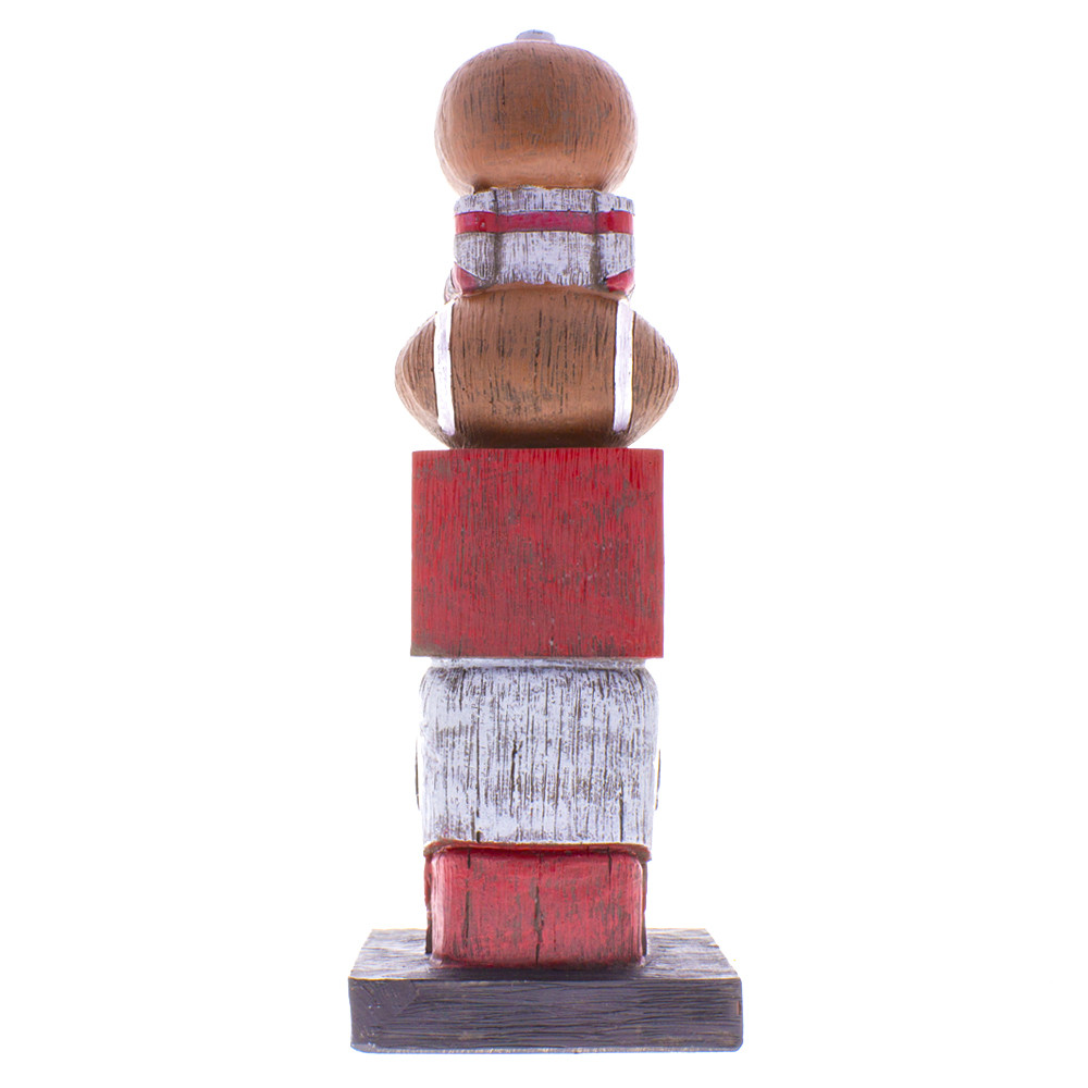 Back view of the OSU college football Ohio state tiki totem pole with football player on the bottom, block O, a football and Brutus on top.