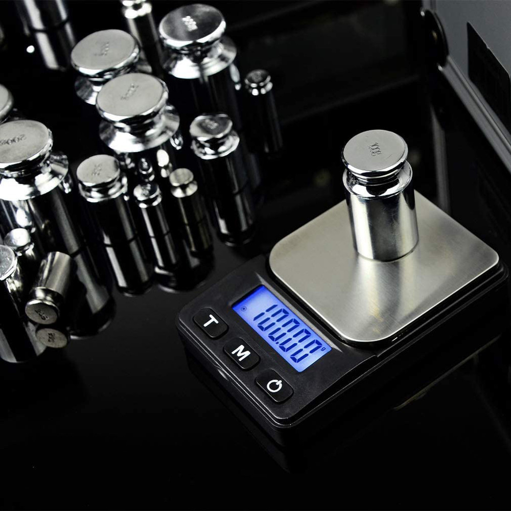 """A 100 gram weight set on a scale which has been calibrated to display """"100."""""""