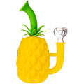 A yellow Silicone Pineapple Bong with its included dry herb bowl.