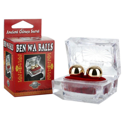 Ben Wa Balls resting in their crystalline carrying case, next to the packaging box.
