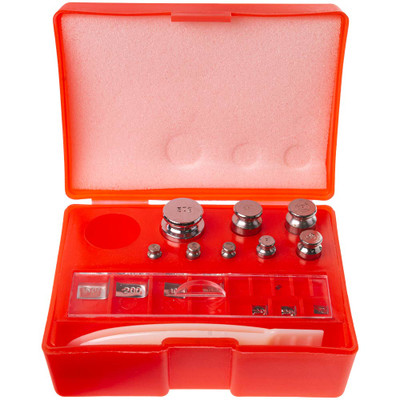 An open box revealing all the weights contained within this Scale Calibration Weight Kit.