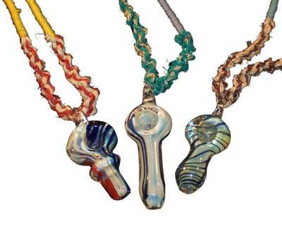 Various Pendant Pipes in an assortment of colors, hanging on a hemp cord.