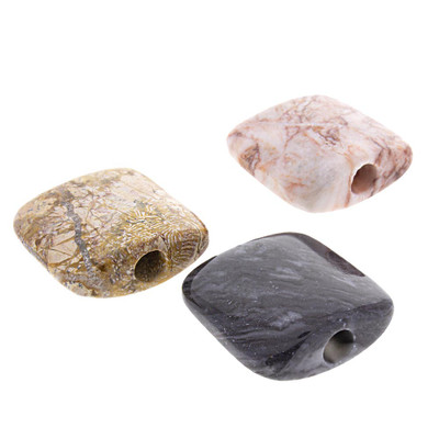 Quarter view of these Onyx Smoking Stones showing their opening, in Tan, Rose, and Black.
