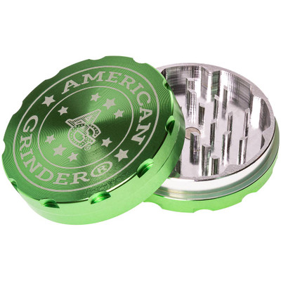 A green American Grinder 62mm 2 Part Grinder with its top removed.