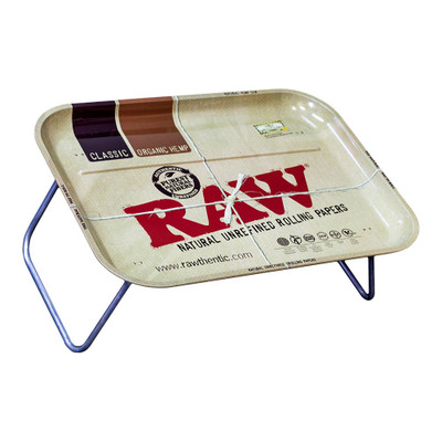 Raw XXL Metal Rolling Tray with Legs has an Organic Hemp paper print on its surface.