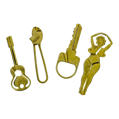 Brass Clips are available in a range of styles. Pictured from left to right: Guitar, Wrench, Key, and Lady.
