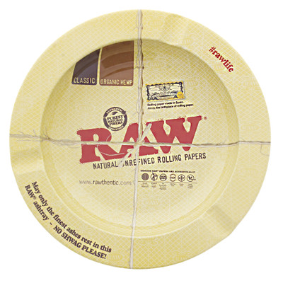 Raw rolling papers round metal ashtray.