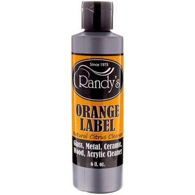 Front view of a 6 ounce bottle of Randy's Orange Label Cleaner.
