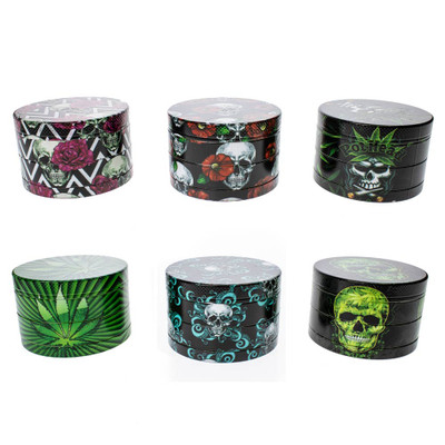 Skull heads, pot leaves, roses and more are all pictured on these 4 part herb grinders.
