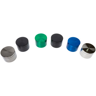 Assorted color metal grinders for dry herbs.