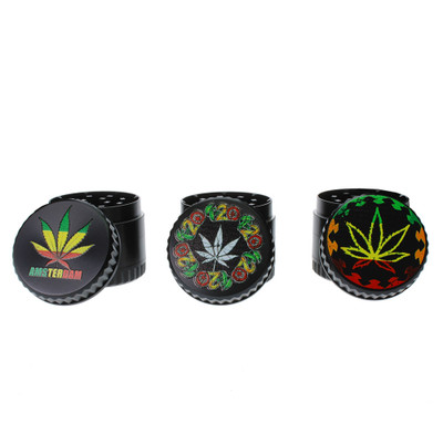 Assorted black grinders with pot leaf in rasta colors on an all black metal body.