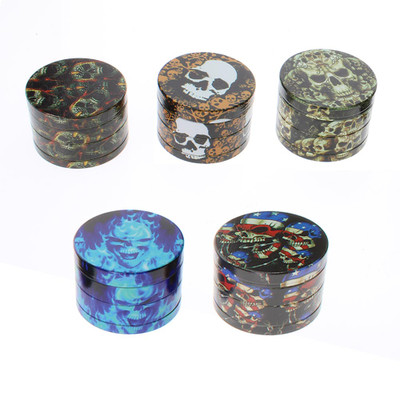 Assorted metal grinders with skull graphics.