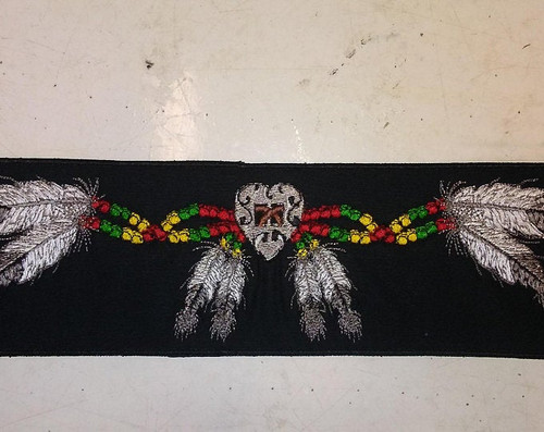 Native American rocker with feathers and beads