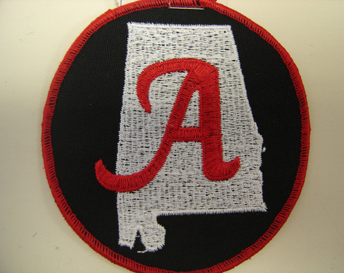"Alabama state patch  3.5"" circle  Red ""A"", White state, Black background,"