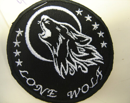 """Lone Wolf""  3"" circle  Black border"