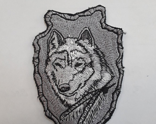 3.5 arrow head and wolf patch