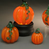 Glass pumpkin, Orange classic style pumpkin, all glass, handsculpted in Sherwin Art Glass studio in Bellows Falls, Vermont by glass artisan Chris Sherwin. Showcased here glowing glass pumpkin on illuminating light base.