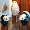 Glass Snowy Owl, perched above two glass Panda bear sculptures at Sherwin Art Glass glassblowing studio in Bellows Falls, Vermont.