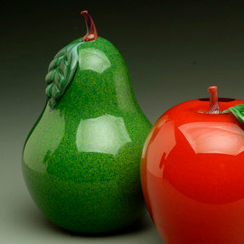 "Jade Green Pear, hand-sculpted glass, with torchworked green  leaf and stem. (Shown with Red Blush Apple), 4"" tall."