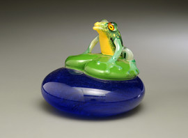 """Green Frog on lily pad, over """"water"""" background...all hand-sculpted solid glass, with torchwork coloration accents and clear encased lifelike murrine eyes!"""