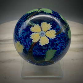 Floral glass millefiori paperweight using California Technique torchwork floral pattern and COE 104 glass made in Bellows Falls, Vermont by glassblower Chris Sherwin using renewable resources.