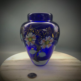 "Cherry Blossom vase, over Cobalt & Gold Foil background. This gorgeous example features 4 blossom 5-petal flowers, with stylized center canes, and leaves/branches, using the California style all glass torchworking techniques he learned while working at Orient & Flume Art Glass in Chico, CA--it is a technique best described as ""Painting with glass"". This elegant footed vase is about 6.5"" tall and 5"" wide.  One of a kind, but can be reproduced upon request if sold. hand-sculpted and free blown glass (no molds here!) by glassblower Chris Sherwin, made in Vermont."