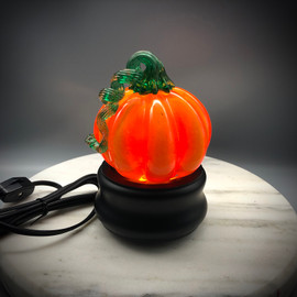 "One of several light bases now offered at Sherwin Art Glass, great for displaying  Glasswork made here at the glassblowing studio, such as glass paperweights, Jellyfish, Pumpkins, glass snowmen, etc.  Light up your home with these great little nightlights! Several styles available. approximately 2"" tall and 4"" in diameter; features replaceable night light bulb (4 or 7-watt only) with 6' plug-in cord."