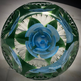 Powder blue Crimp Rose paperweight, with heart shape center bud, millefiori center cane behind the petals, and 6/1 facet and Picket fence cutting by James Poore of Cape Cod, MA