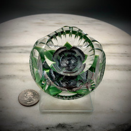 Gorgeous one of a kind Purple Ripple  Crimp Rose paperweight, with heart shape center bud, green/black variegated leaves coming to point, made by glass artisan Chris Sherwin in his glassblowing studio in Bellows Falls, Vermont; this weight showcases a 5/1 facet and Picket fence cutting by James Poore of Cape Cod, MA