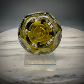 Yellow Rose of Texas Rose Crimp Rose paperweight, with heart shape center bud, green/black variegated leaves coming to point, made by glass artisan Chris Sherwin in his glassblowing studio in Bellows Falls, Vermont; this weight showcases a 6/1 facet and Picket fence cutting by James Poore of Cape Cod, MA