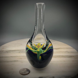 "Yellow Crocus bud vase,  with slender torchwork green variegated leaves made by glass artisan Chris Sherwin in his glassblowing studio in Bellows Falls, Vermont; this vase showcases the California torchwork decorative ""Painting with glass"" techniques learned while working at Orient & Flume Art Glass....."
