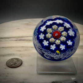 Millefiori concentric over medium blue with white lace background. Made by Glass Artisan Chris Sherwin in his Bellows Falls VT glassblowing studio
