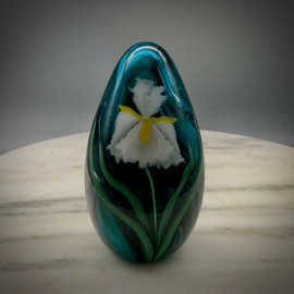 "White Iris Egg paperweight, glass paperweight, with torchwork Iris and slender leaves, over Turquoise swirl background, handmade by Glass Artisan Chris Sherwin at his glassblowing studio in Bellows Falls, VT, 4"" tall. One of a kind."