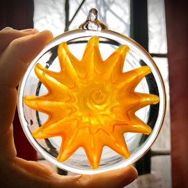 """Glass Suncatcher Mandala, to hang inside or outside and promote """"Sunshine & Happiness"""" in your home. approximately 4"""" diameter, with loop for hanging."""