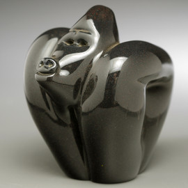 hand-sculpted, all Glass Gorilla --Standard Black--won't look as shiny metallic as in this image.