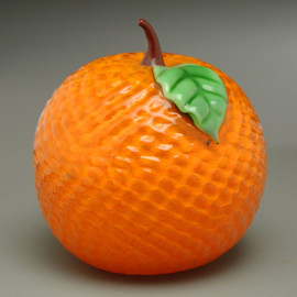 Summertime Classic.  Glass Fruit Orange, with surface dimples and colorful glass leaves and stem.