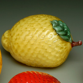 All Glass Lemon, with dimpled surface decoration and glass leaf and stem.