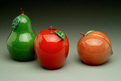 """Jade Green Pear, hand-sculpted glass, with torchworked green  leaf and stem. (Shown with Red Blush Apple and Peach), 4"""" tall."""